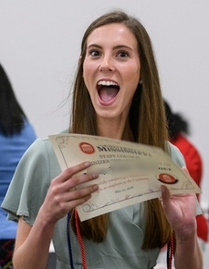 Smiling Student Holding a certificate